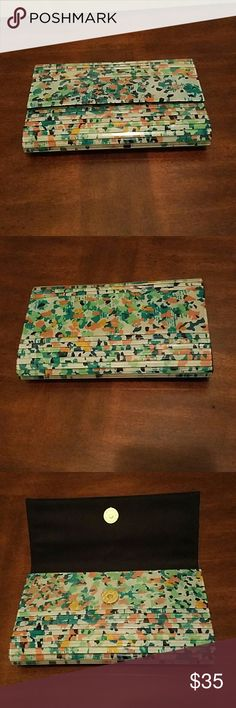 BCBG Wristlet Adorable Wristlet in Agate multi with clear coating.  It's in great condition besides some minor scratches. BCBG Bags Clutches & Wristlets