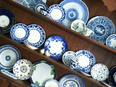 flow blue and white china in hutch