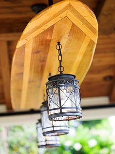 outdoor beach decor - Google Search @Ana Cahill You need a surfboard light fixture in your kitchen!