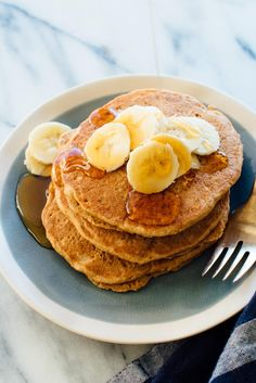 These whole wheat pancakes are delicious and fluffy, with a hint of cinnamon. They're naturally sweetened with maple syrup instead of sugar. So good!