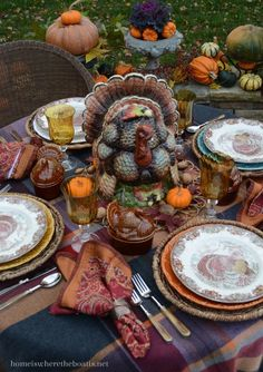Back: Thanksgiving Round Up of Recipes and Table Inspiration Shades of purple, plum, terracotta and pumpkin in a plaid fringed throw provide a warm and colorful foundation for a turkey tureen and Thanksgiving table Fall Table Settings, Thanksgiving Table Settings, Beautiful Table Settings, Thanksgiving Tablescapes, Thanksgiving Feast, Holiday Tables, Thanksgiving Decorations, Table Decorations, Christmas Tables