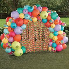 Luau Lantern Archway Idea | Luau like never before with this colorful addition to your DIY party decorations! Makes a great party entryway or spot for luau photos and party selfies. #party