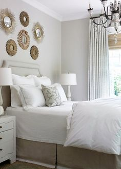 Sunburst Mirrors over bed