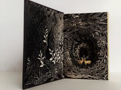 """""""Seattle-based artist Isobelle Ouzman carves intricate illustrations into discarded books found in dumpsters and recycling bins Altered Books, Altered Art, Tunnel Book, Art Journal Techniques, Diy Art Projects, Book Sculpture, Bookbinding, Paper Art, Cut Paper"""