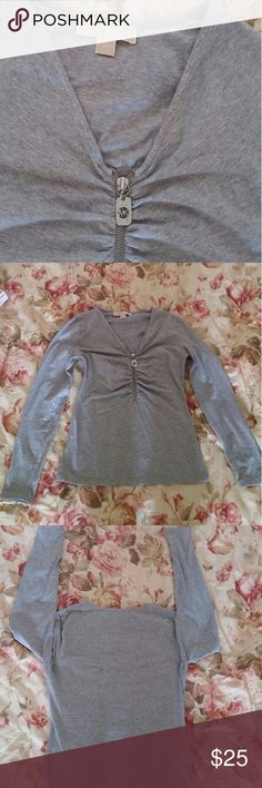 Michael Kors tshirt size XS Nice tshirt in gray color  95% cotton  5% spandax Used few times in good condition Michael Kors Tops Tees - Long Sleeve