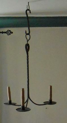 "18th C. American or English of hand wrought iron 20"" high and 15"" across"