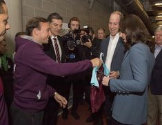Kate Middleton Photos - Prince William, Duke of Cambridge and Catherine, Duchess of Cambridge chat with West Ham player, Mark Noble and West Ham manager Slaven Bilic during the Coach Core graduation ceremony for more than 150 Coach Core apprentices at The London Stadium on October 18, 2017 in London, England. - The Duke of Cambridge and Prince Harry Attend the Coach Core Graduation