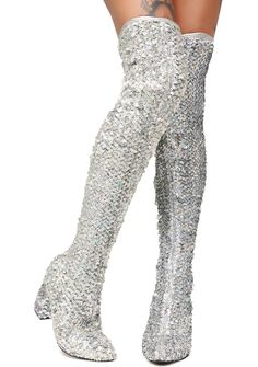 Current Mood Sparkler Thigh High Boots cuz bb you're more than a firework to me. These silver thigh high boots have a stretchy fit and iridescent sequins all ova with a zipper closure on the side.