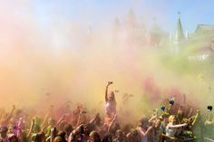 People throw coloured powder during the Holi Festival in Moscow