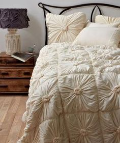 Ivory Rosette Quilt: Steer clear of color and opt for an ultra-feminine quilt, which adds a touch of sophistication.