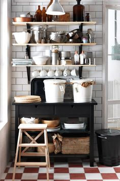 black white wood :: metro tiles, vintage style floors, open shelves, black kitchen island (Förhöja I think) - all by Ikea
