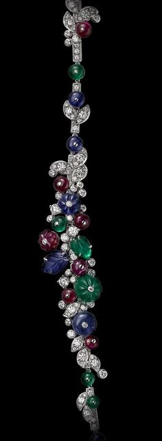 Platinum, sapphire, ruby and emerald beads, sapphire and emerald carved leaves, brilliants. Detail of the necklace
