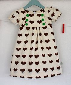 adorable heart dress.  love the green buttons.