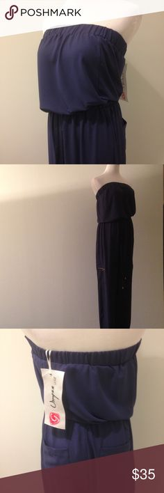 NEW! Gorgeous Navy Blue Jumpsuit 50% polyester 50% rayon. Sleeveless one piece with elastic at bust and waist. Back pockets, side zipper pockets, and drawstring waist on pants. Size medium shown on a size medium. No trades. Umgee Pants Jumpsuits & Rompers