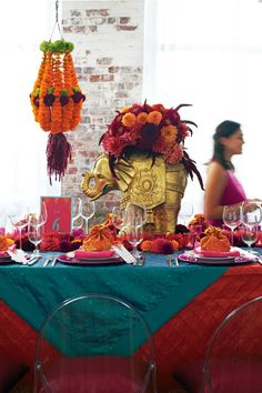 from Seattle Met Bride & Groom: bright saturated teal, fuschia and orange decorate this South Asian-inspired table design by Varmala Design. Photo by Dennis Wise.