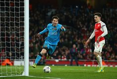 Lionel Messi of Barcelona celebrates after scoring the opening goal during the UEFA Champions League round of 16 first leg match between Arsenal and Barcelona on February 23, 2016 in London, United Kingdom.
