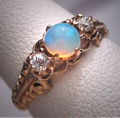 Antique Victorian Australian Opal Mine Cut by AawsombleiJewelry, $1895.00. Oh my god this is gorgeous!!