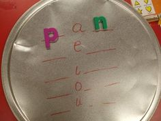 Use a pizza pan to hold magnetic letters as children practice working with medial vowel sounds. After making the words on the pan, the children write the words down on paper. Phonics Centers, Kindergarten Centers, Teaching Kindergarten, Teaching Reading, Fun Learning, Preschool, Teaching Phonics, Phonics Activities, Phonics Words