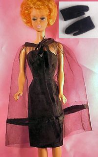 Vintage Barbie Black Magic  #1609Vintage Barbie Black Magic (1964-1965)     Strapless Black Dress  Black Tulle Cape  Short Black Gloves  Gold Dimple Clutch Purse  Black Open Toe HeelsVintage Barbie Black Magic    This elegant ensemble is a favorite of collectors.  It is rumored to be inspired by one of Ruth Hadler's (Barbie's creator) favorite ensembles.  The black sleeveless dress is made of silk shantung and has a back zipper.