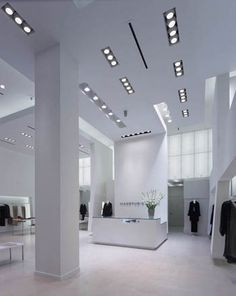 Max Studio store in San Diego by George Yu architects. I like the whiteness and spacious layout but there is way too much happening in the ceiling.