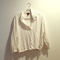Slightly sheer white breezy top Slightly sheer, white breezy top from H&M. The shirt is collared with a half-length v-neck cut. The sleeves are about 3/4 length and the bottom of the shirt has a drawstring hem. Super cute and in excellent condition! H&M Tops Tees - Long Sleeve