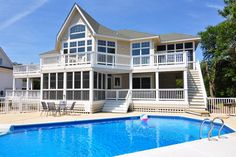 CC152: Billy's Banks | Corolla Rentals | Village Realty. Outer Banks NC. 4 bedrooms, 4 full baths and 1 half bath. Enjoy your private 16 x 32 pool and hot tub located on the screened porch and outdoor shower. TVs, DVD player, WiFi, two screened porches and grill. Relax in the den or play a game of Foosball.