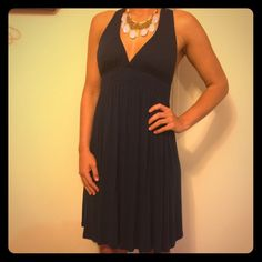 Summer dress Navy blue, Super cute, and comfy dress. It has padding in the chest area. The crisscross cross back makes this dress stand out. Dress it up with bold jewelry or down for the beach. Barely worn and is in perfect condition. 95% rayon 5% spandex. Necklace is sold in separate listing. Dresses Midi