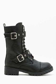 Super versatile black leather combat boots featuring a black lace-up front and two buckles with silver hardware.