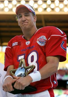 Peyton Manning #18 of the AFC team holds his MVP trophy after the NFL Pro Bowl on February 13, 2005 at Aloha Stadium in Honolulu, Hawaii.