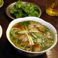 Paper-thin slices of top round or sirloin are cooked along with rice noodles in individual serving bowls into which hot beef broth fragrant with lemon grass, ginger, and cinnamon is poured.