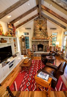 Oak floor and weathered timbers-- Home in Jackson, Wyoming - Rustic - Living Room - Other Metro - Trestlewood