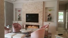 "96"" linear contemporary gas fireplace with beige natural stacked stone on wall."