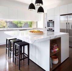 Loving the white/grey marble bench tops and dark wood floors
