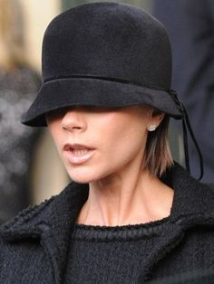 Victoria Beckham in her Vintage Cloche hat. Not sure how she sees, but it sure looks fabulous.