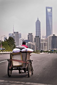 Shanghai. This image sums up this city perfectly. The poor were displaced to build these high rises, but many were still visible.