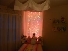 this is a set of net Christmas lights I put behind some sheer curtain panels in my granddaughters room for nightlights!