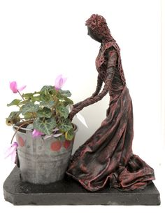 Garden Sculpture. Contemporary Outdoor Sculpture of a Lady Planting into her bucket. £40.00 and can be found at 'The Garden Place' Blackpool, UK.