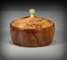 Keepsake box of Claro Walnut, with Elm Burl lid, Yellowwood pull, by New England woodturner Ray Asselin. At Bowlwood.com.