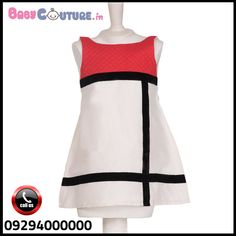 3b4cd6f82494 The black and white striped top has a cute doll as a broach that is ...