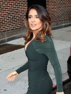 Salma Hayek. Her hair is exactly what I want! Mine is close, but I need to add a few more highlights