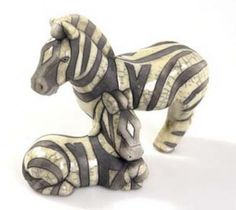 Raku pottery zebra and calf sold by Twizzles, artist unknown.