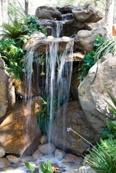 It's not difficult to create a waterfall pond feature rather than the conventional pond. With this small waterfall pond landscaping ideas you will inspired to make your own small waterfall on your home backyard. Pond Waterfall, Small Waterfall, Waterfall Design, Waterfall Project, Diy Pondless Waterfall, Waterfall Shower, Outdoor Water Features, Water Features In The Garden, Backyard Water Feature