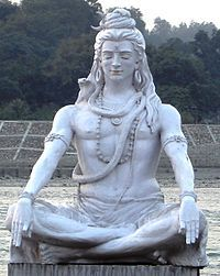 The statue of Lord Shiva on the bank of the Ganges in Rishikesh is the major tourist attraction of city. Its is situated in front of Parmarth Niketan Ashram, Rishikesh and Ganga Aarti is held every evening in front of the statue. Lord Shiva Statue, Lord Vishnu, Sitting Posture, Hindu Deities, Ganja, Gods And Goddesses, Indiana, Lion Sculpture, Spirituality