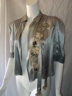 Art Deco Satin Bed Jacket Embellished with Floral Applique Soutache and Sequins Basket metallic lace 1920s. $345.00, via Etsy.