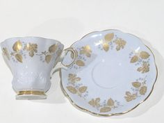 Royal Albert Bone China of England crafted this charismatic sky blue and gold teacup and saucer.  The shape is intriguing from its gold foot to the aristocratic handle. From the bridge table to the office, this tea set is delightful.  Measurements in inches and centimeters: The saucer is 5.5 (14 cm) in diameter. The cup is 3 (7.5 cm) high and 3.5 (9 cm) from rim to rim.  This English teacup and saucer is in excellent condition. We do not sell damaged items. You may buy with confidence. To…