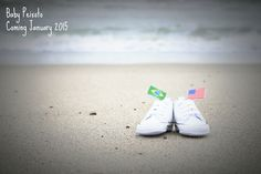 Baby Announcement- baby shoes on beach with both country flags