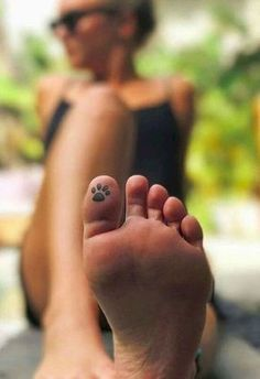 tiny pawprint tattoo