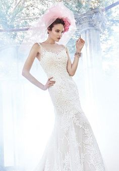 Fit and flare gown constructed of delicate tulle and lace | Maggie Sottero | https://www.theknot.com/fashion/noelle-maggie-sottero-wedding-dress