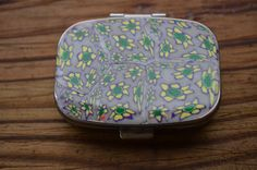 Polymer clay covered pill case daisy by AbandonedAtticCrafts, $8.50