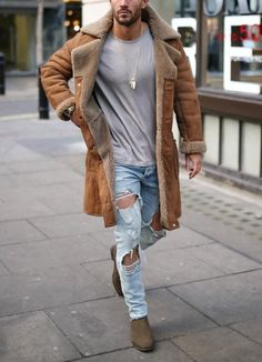 Men's torn jeans, brown coat, and grey t-shirt